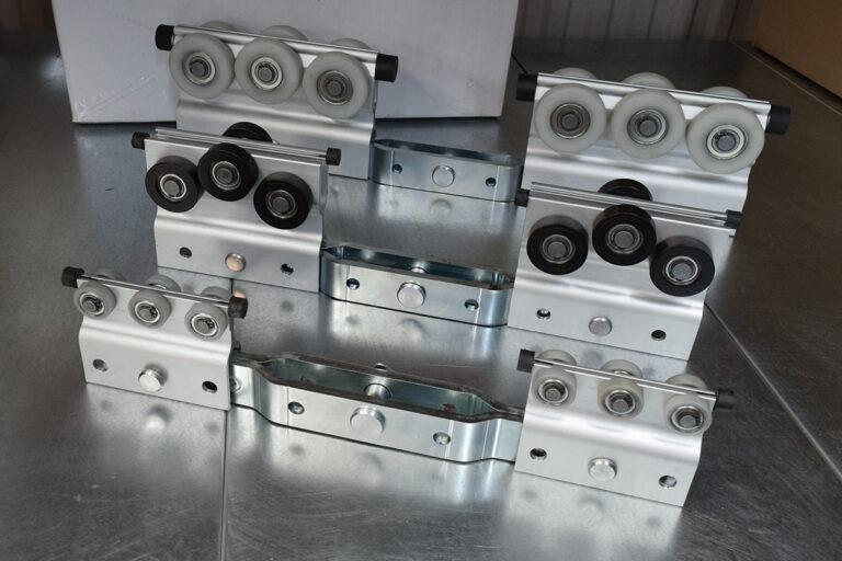 Lastbärande dubbla löpvagnar till Mechrail lättraverssystem i aluminium